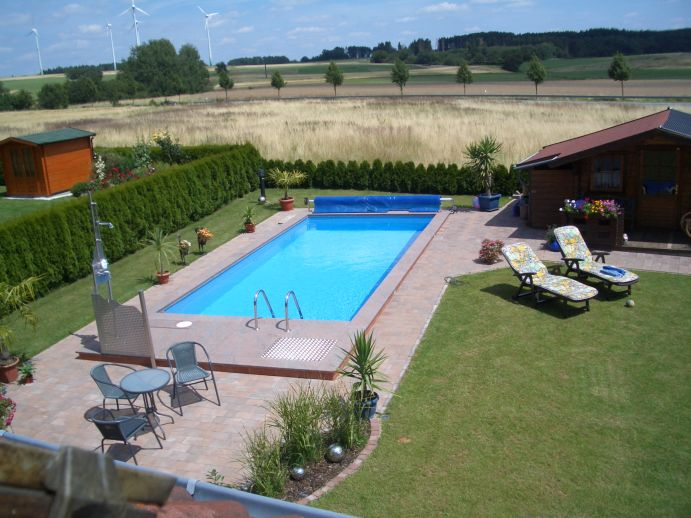 Piscine de jardin avec chauffe piscine solar rapid for Chauffe piscine express